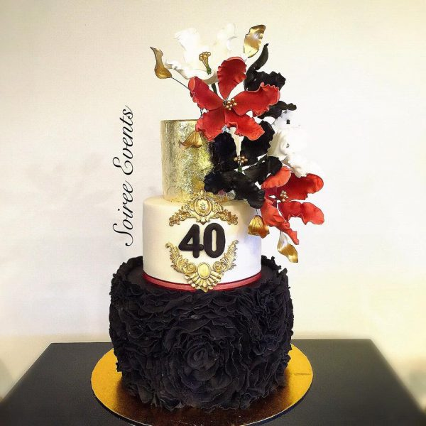 black and gold ruffle cake with burgundy sugar flowers