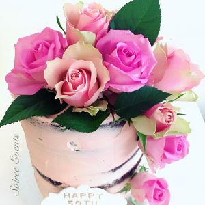 Pink semi-naked cake with roses