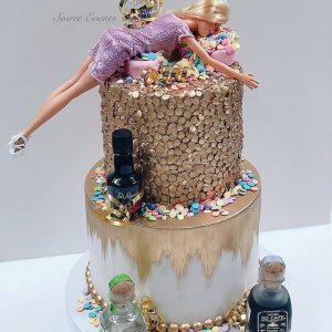 Two tier gold barbie cake