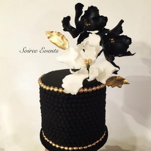 Black cake with sugarflowers
