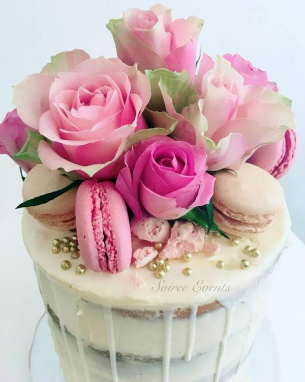 Fresh rose and maMacaron semi naked drip cake 1