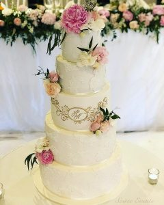 sugar lace and fresh flower wedding cake