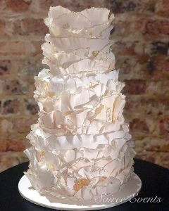 textured ruffle wedding cake with gold edges