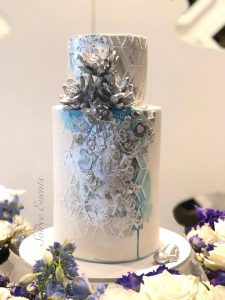 blue white and silver christening cake with silver hand made succulents