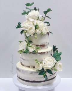 semi naked wedding cake with fresh roses